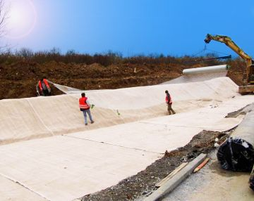 Installation of geogrid using a shovel